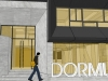 closer-view-of-facade-with-dormus-signage-doubling-as-ramp-rail
